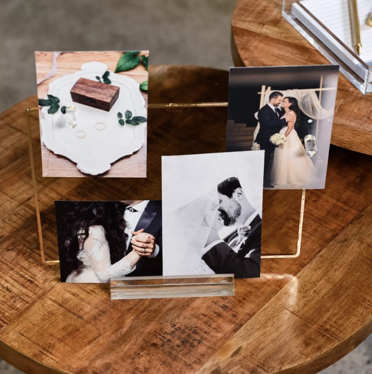 The transparent gold-rimmed acrylic memo display with pictures