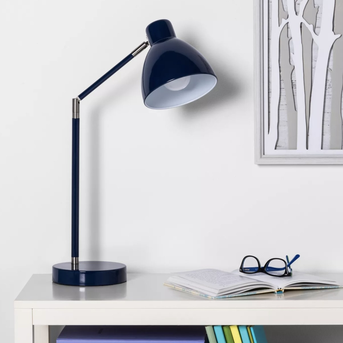 Task table lamp on desk in blue