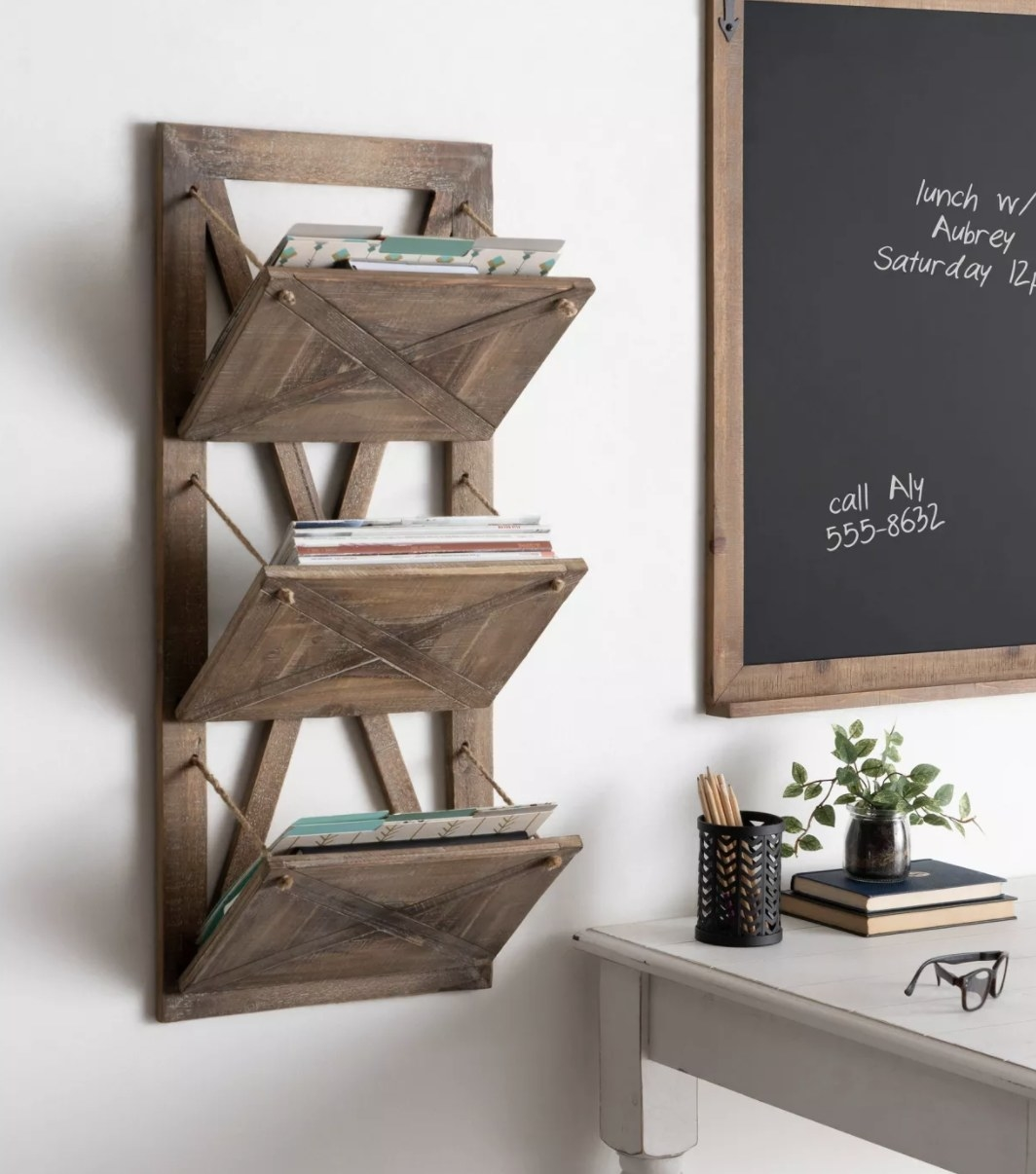 Rustic brown three pocket wall file holder hanging from wall