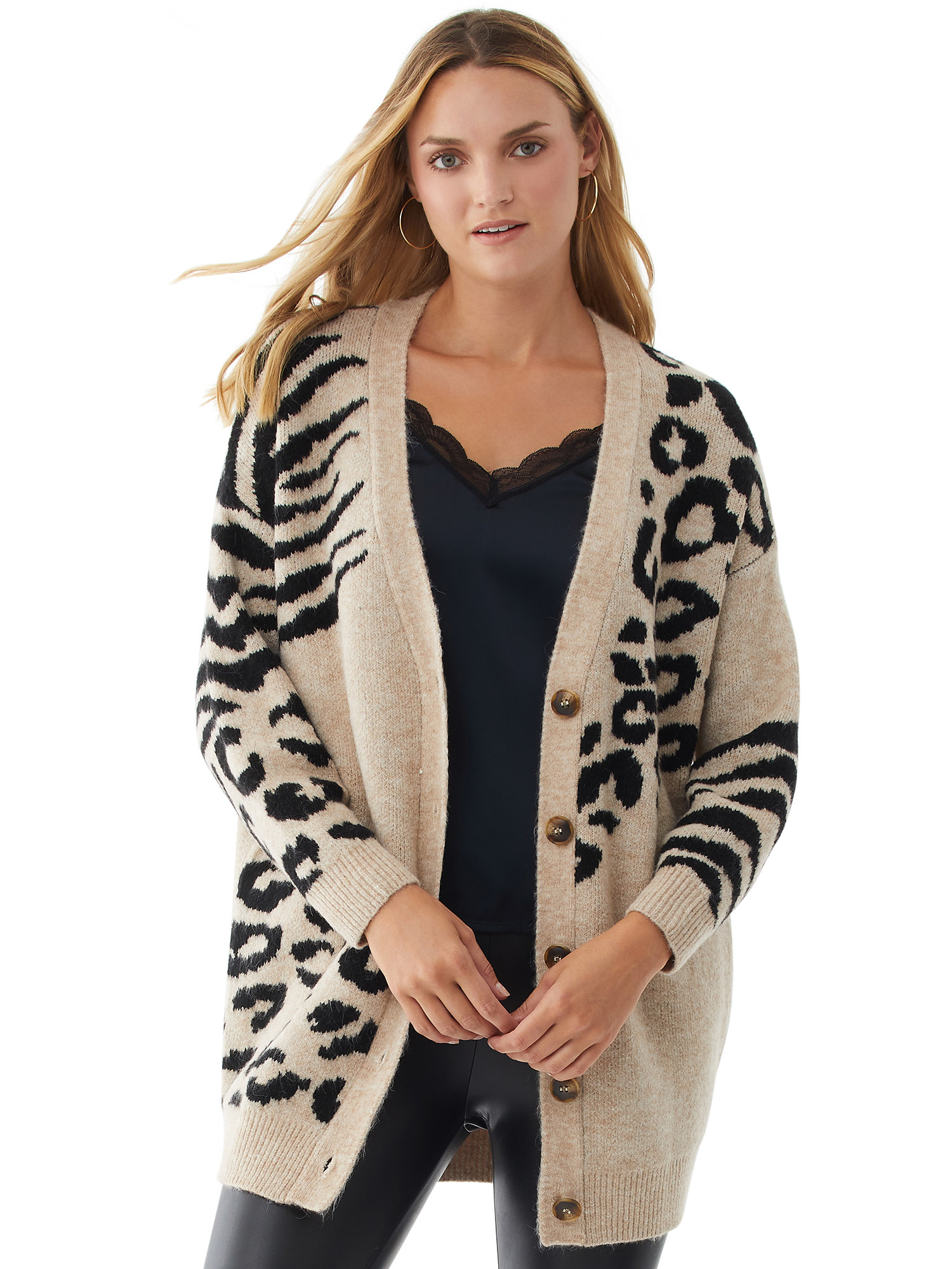 person wearing a beige animal print cardigan