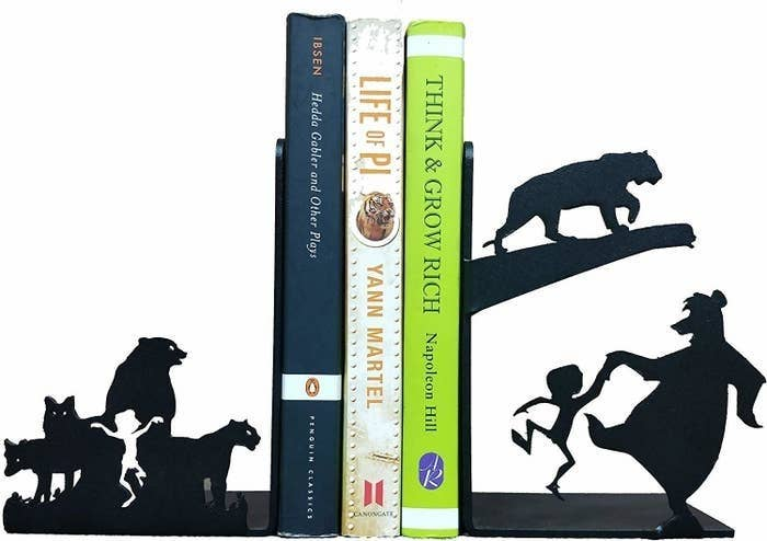 3 books kept in between The Jungle Book themed bookends