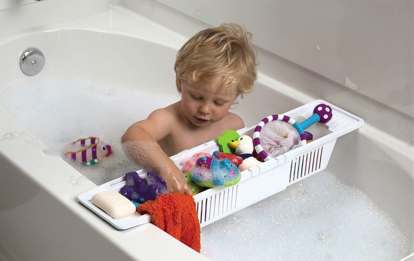 The bath storage basket laid across a tub