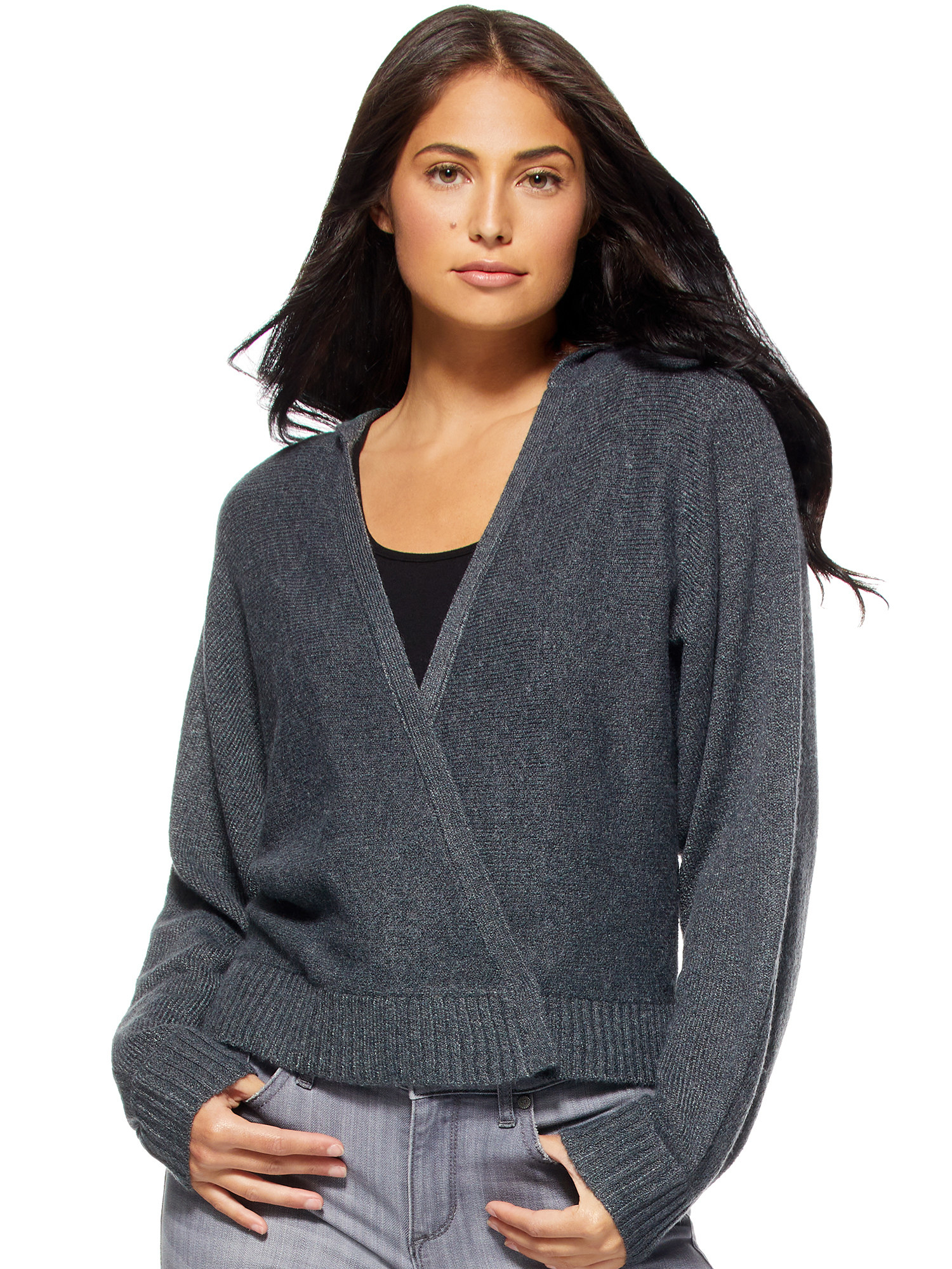 person wearing a gray sweater and gray-washed jeans