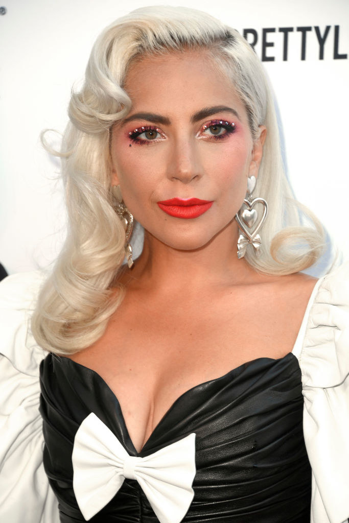 Lady Gaga wearing a dress with a box and makeup with rhinestones