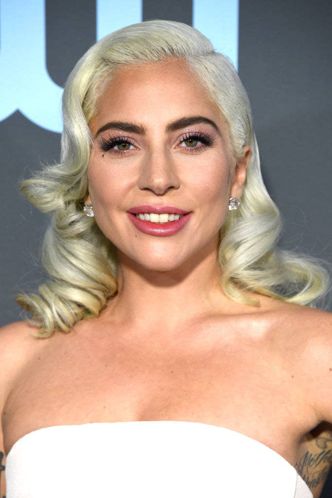 Lady Gaga smiling with her hair curled