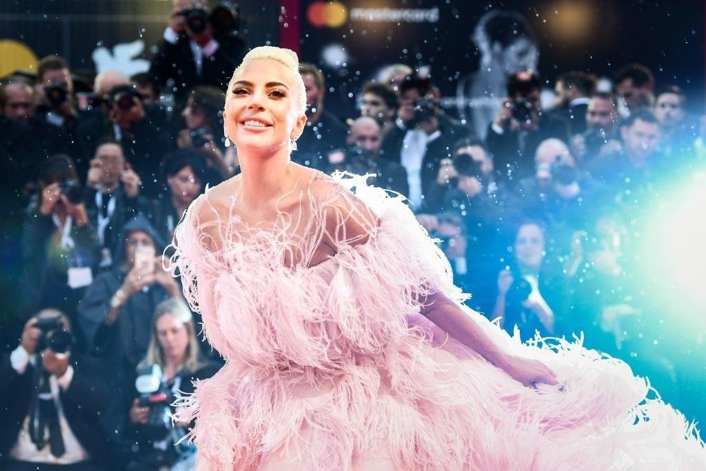 Lady Gaga posing as photographers take pictures