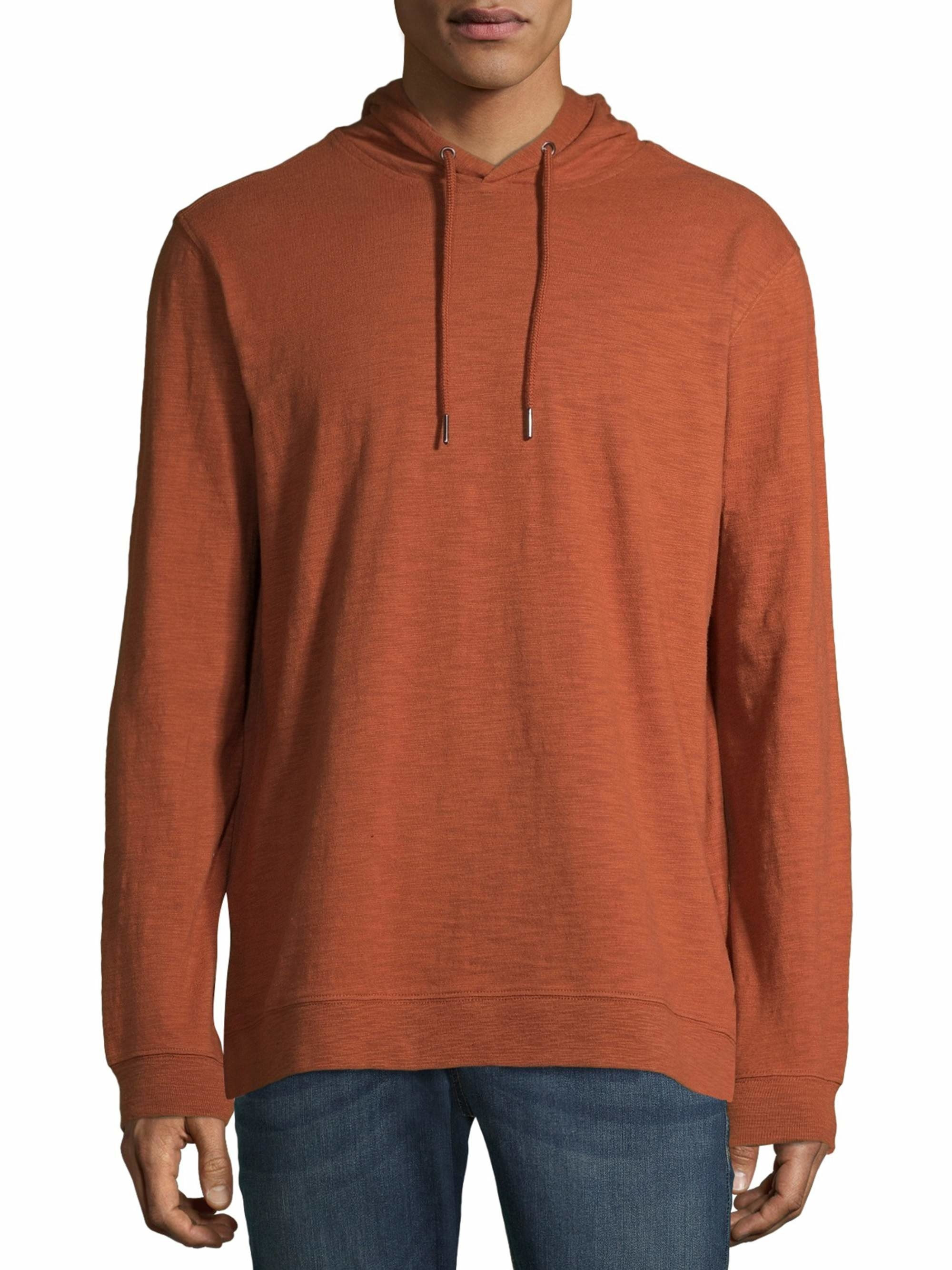 person wearing an orange pullover hoodie