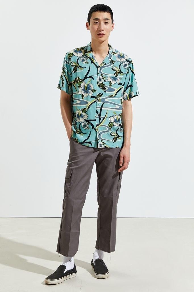 Model wearing Dickies cutoff cargo pants in grey