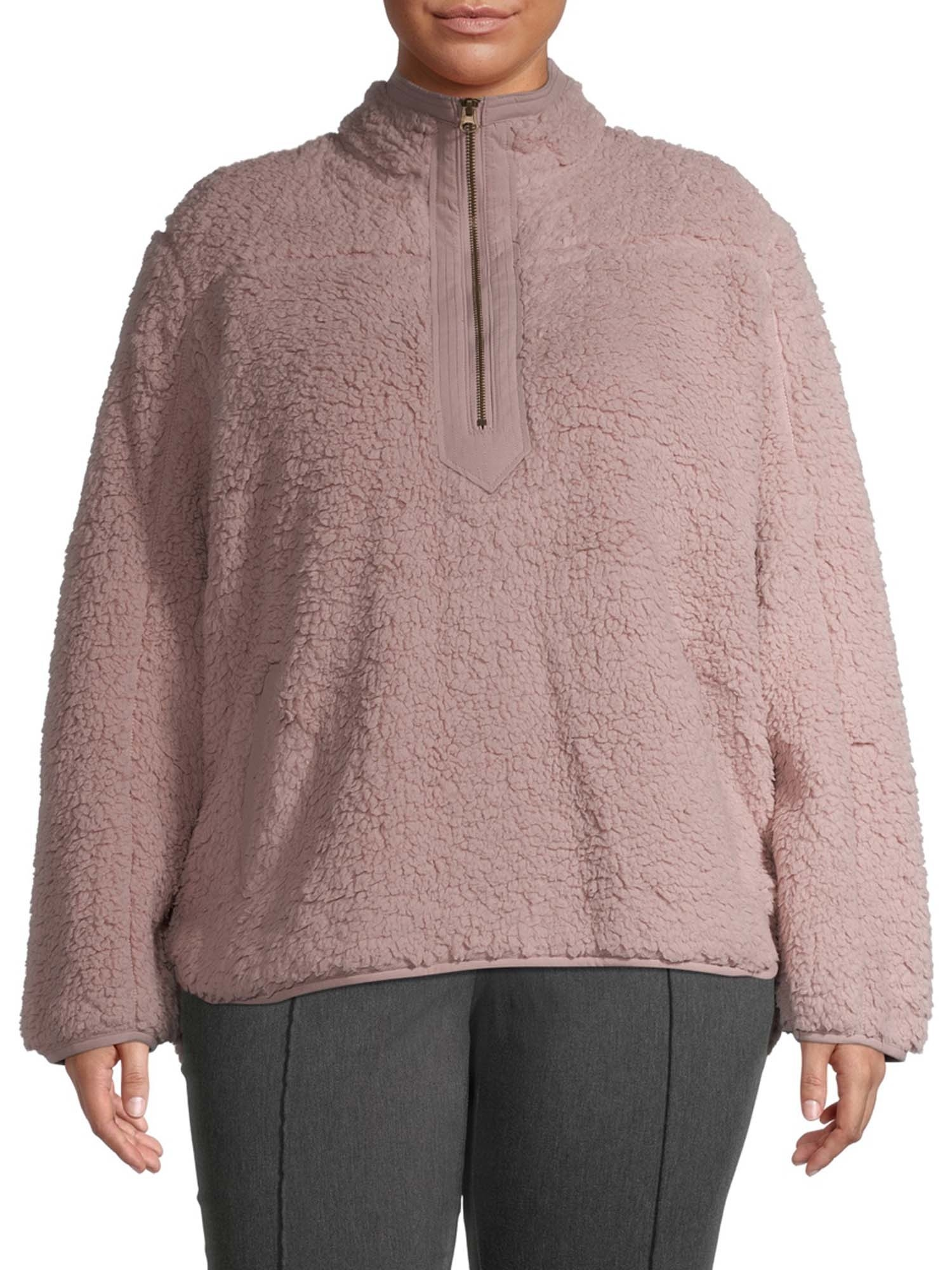 person wearing a pink faux sherpa pullover