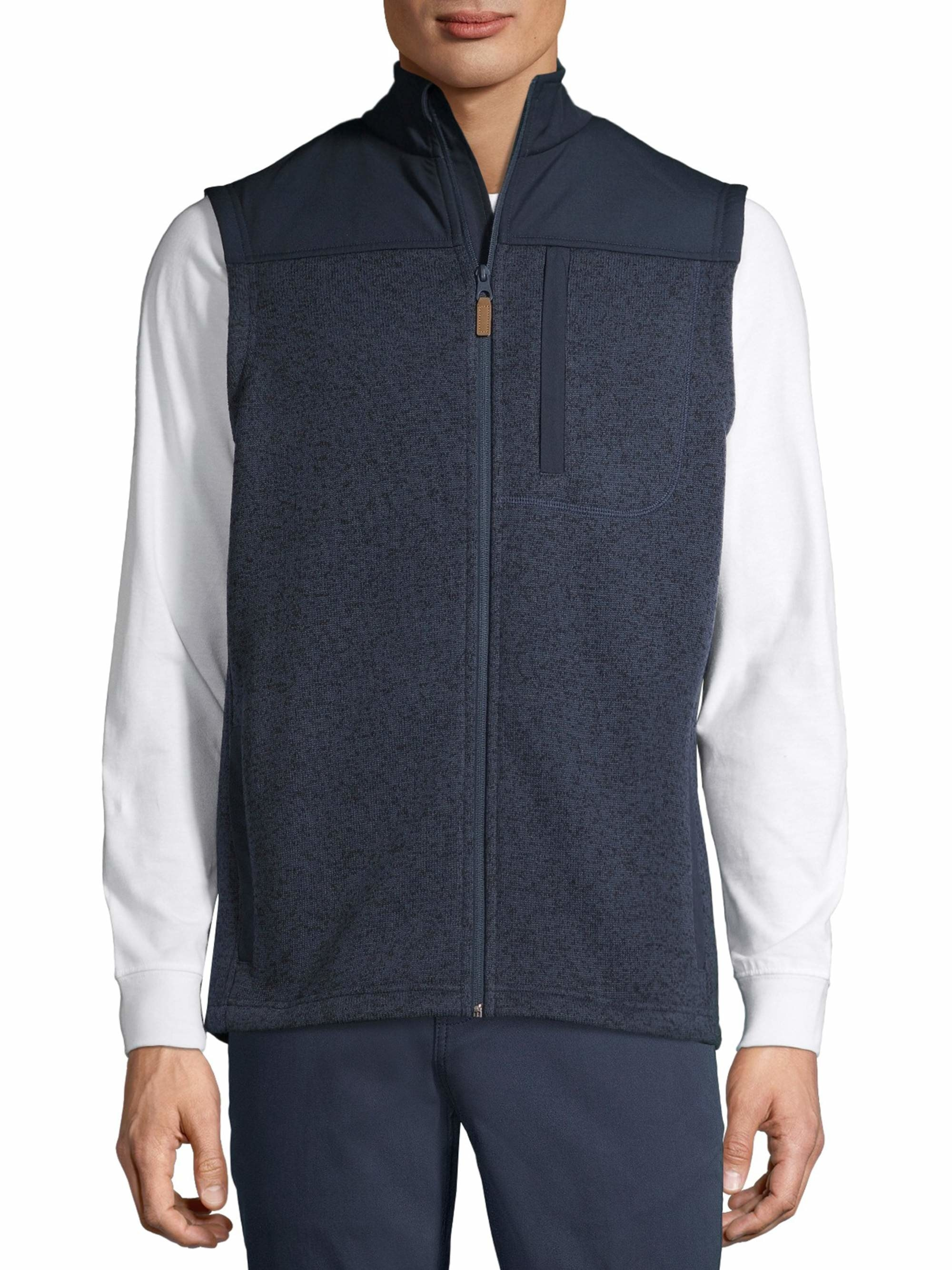 person wearing a blue sweater vest over a white longsleeve shirt