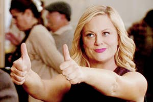 Leslie Knope giving two big thumbs up