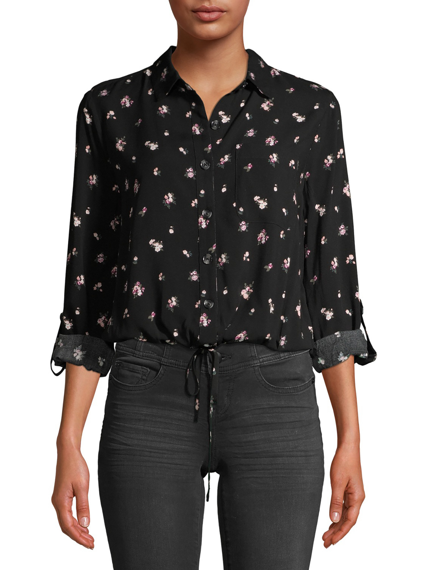 person wearing a black printed top with black jeans