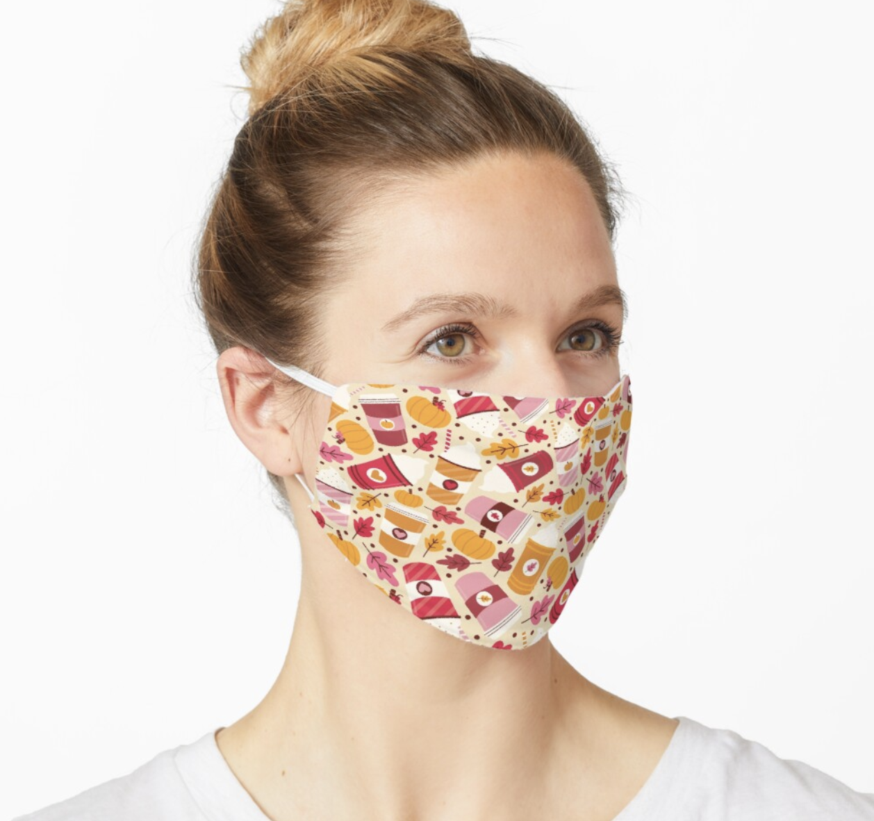 Model in a face mask with cartoon coffee cups, leaves, and pumpkins on it