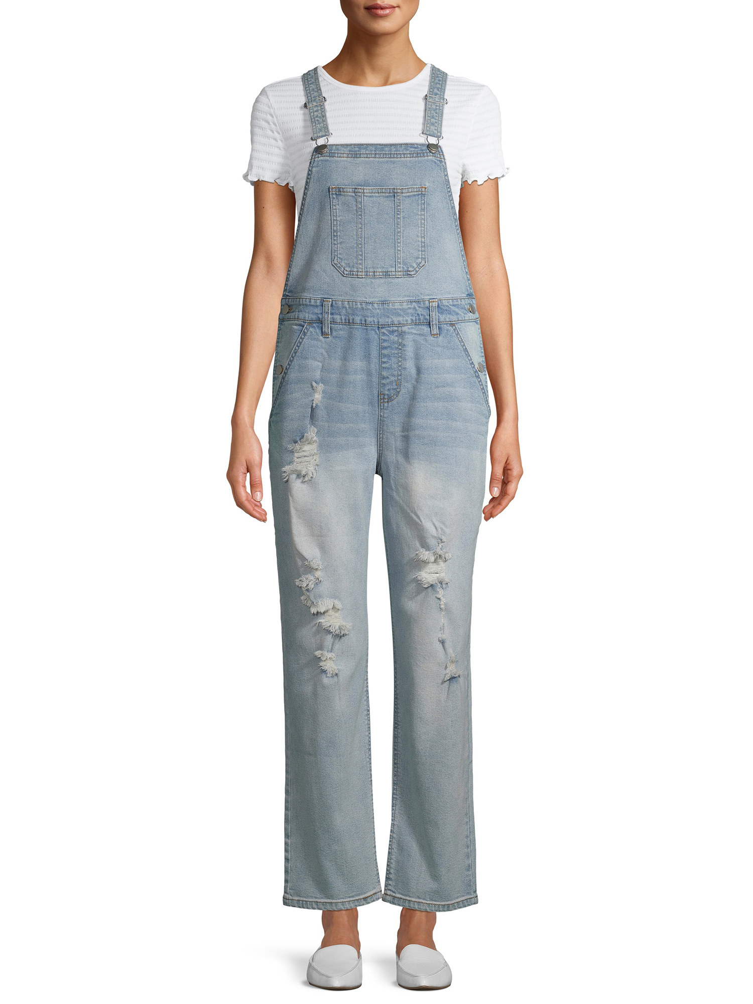 person with a pair of light blue overalls