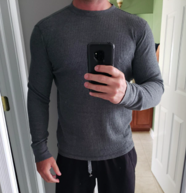 reviewer wearing Amazon Essentials waffle knit long sleeve crew in charcoal