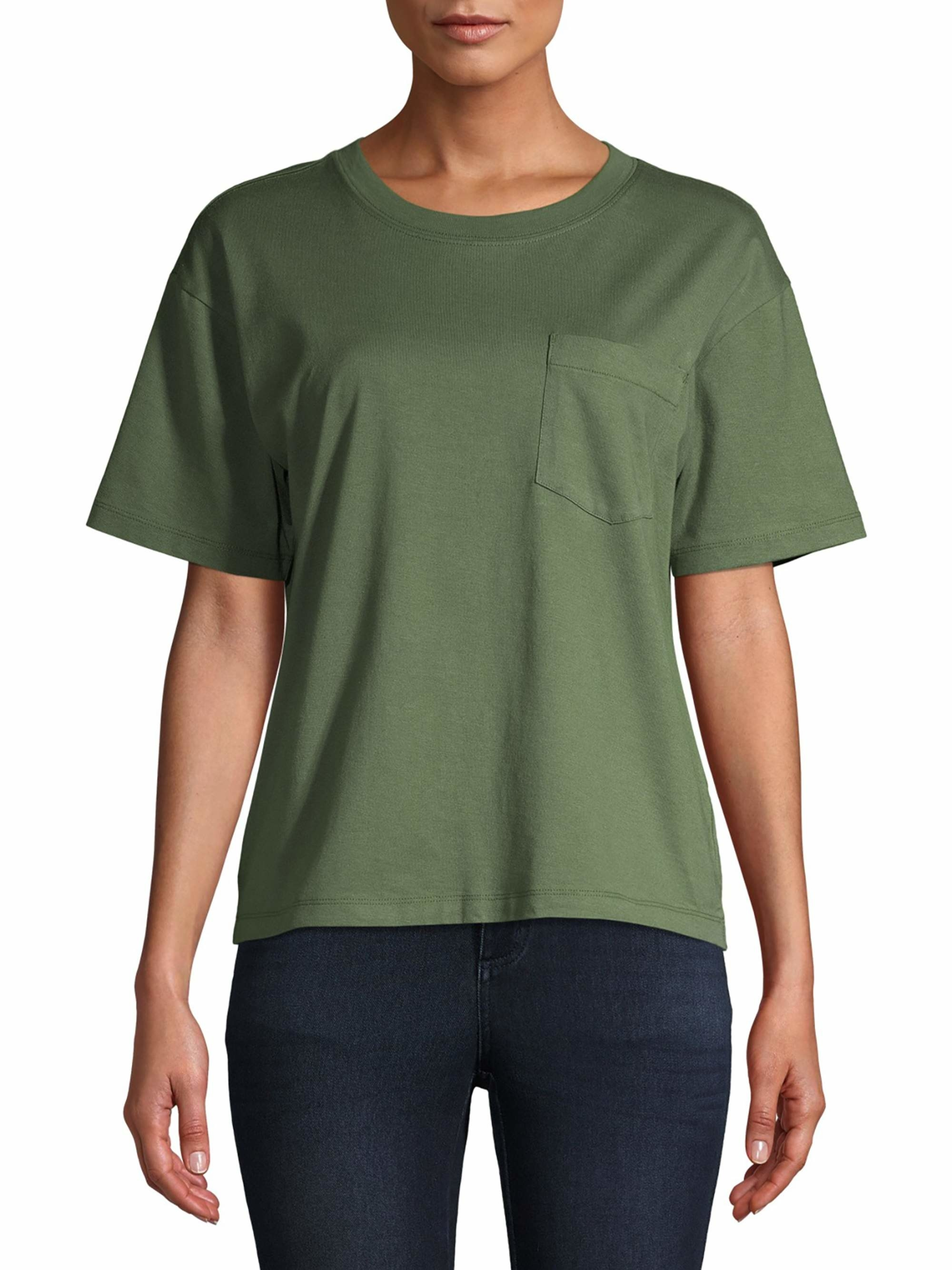 person wearing olive green t shirt with dark jeans