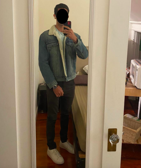 Reviewer photo showing reviewer wearing Levi's sherpa-lined trucker jacket in changing seasons