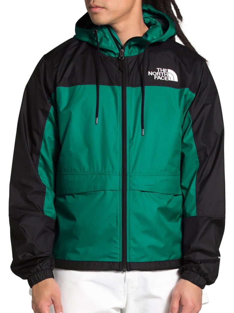 Model wearing The North Face HMLYN wind breaker in evergreen