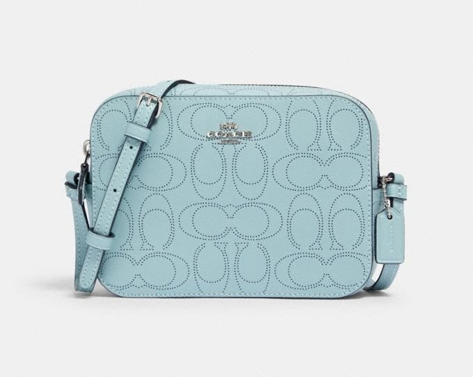 A light blue crossbody bag perforated with the C logo pattern