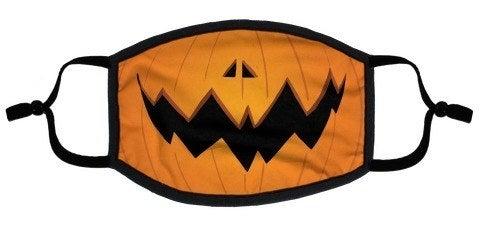 face mask of the bottom half of a jack o lantern smiling