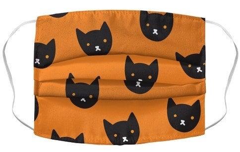 orange mask with cartoon black cat faces