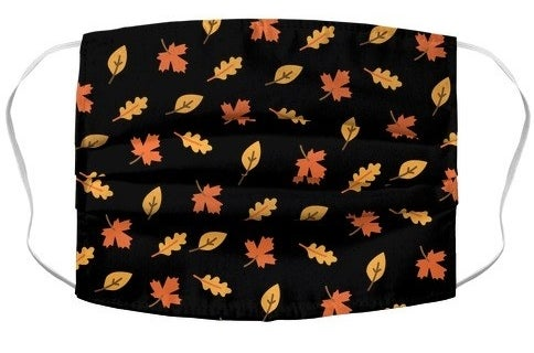 black mask with cartoon leaves pattern