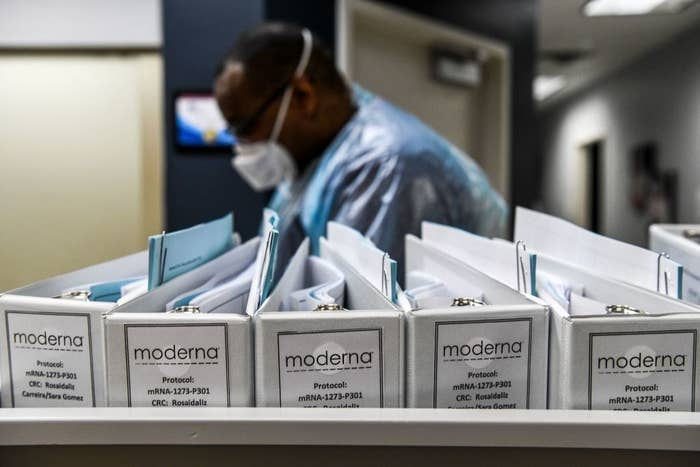 Several binders containing the Moderna vaccine trial protocols