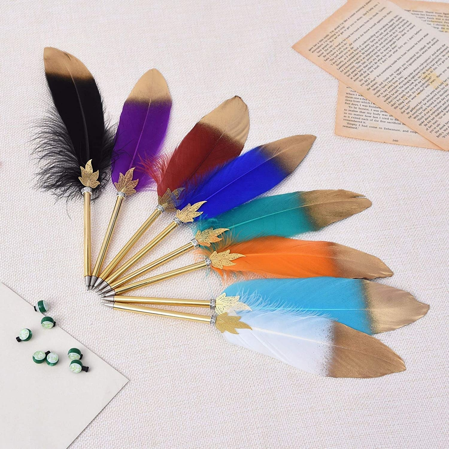 A set of pens with feather quills at the top