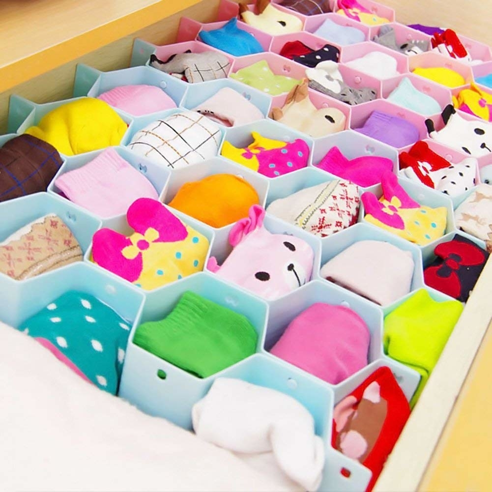 The drawer organisers displayed inside a drawer with socks tucked in separate compartments.