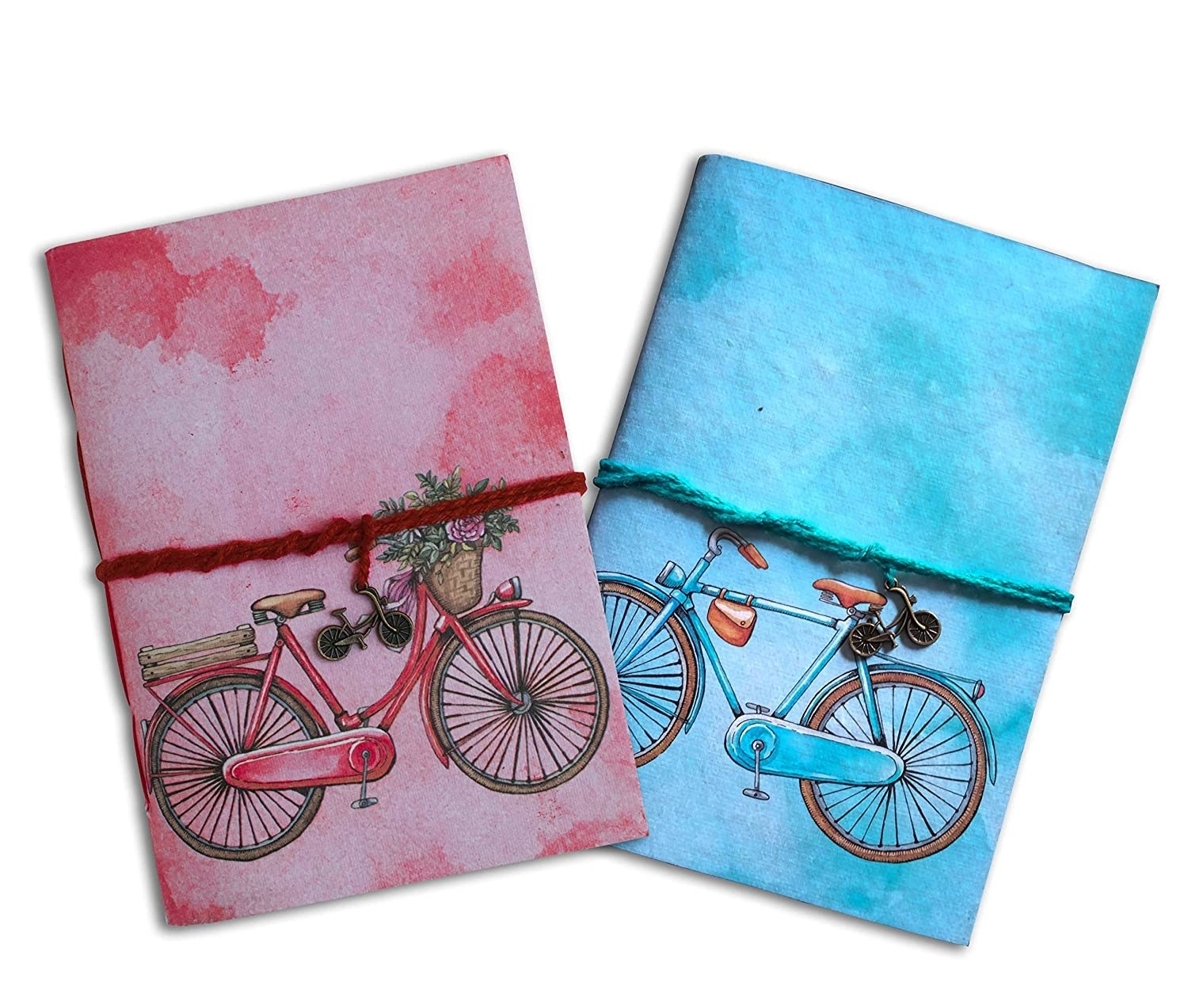 A pink and blue handmade diary with a bicycle on the cover.