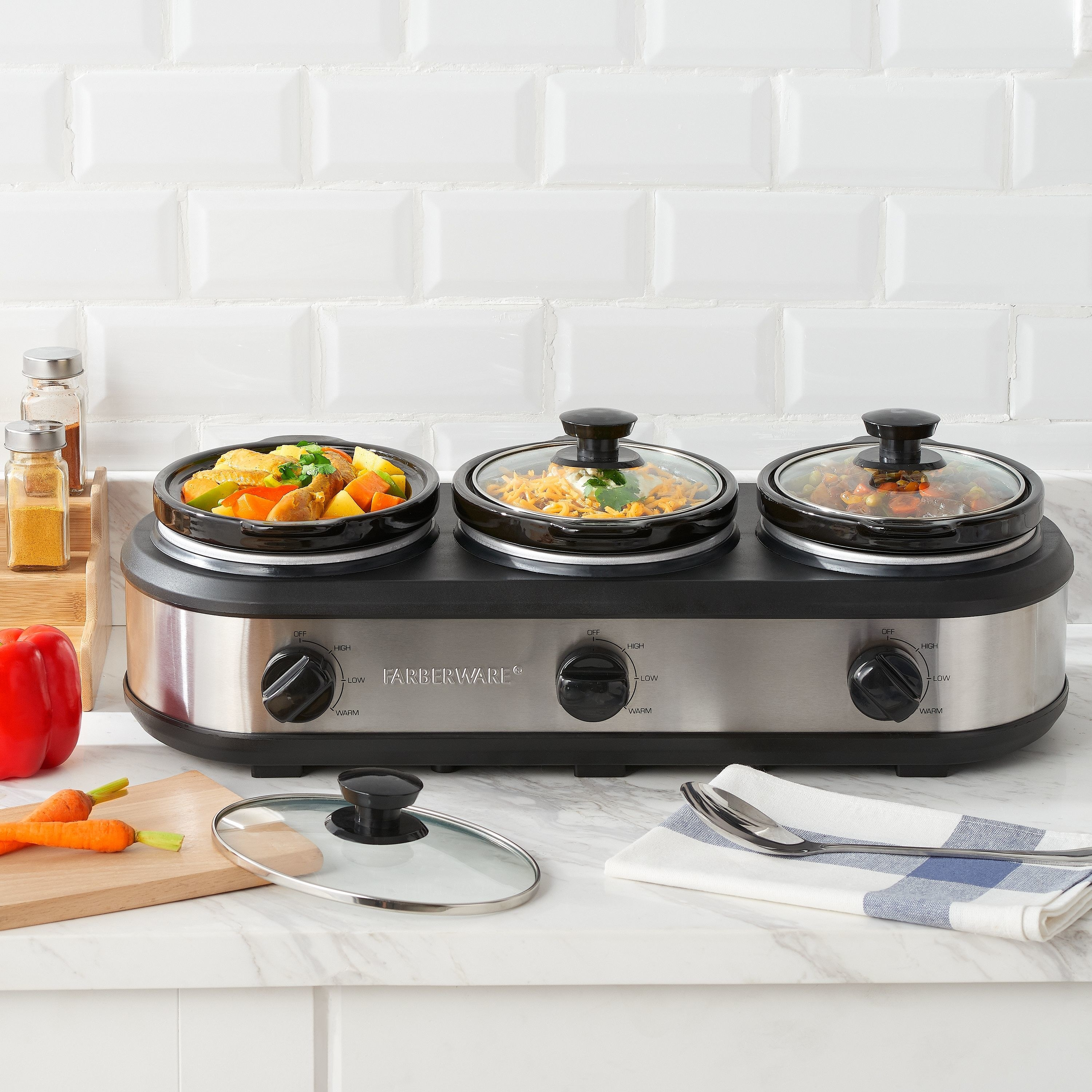 a triple slow cooker on a kitchen counter