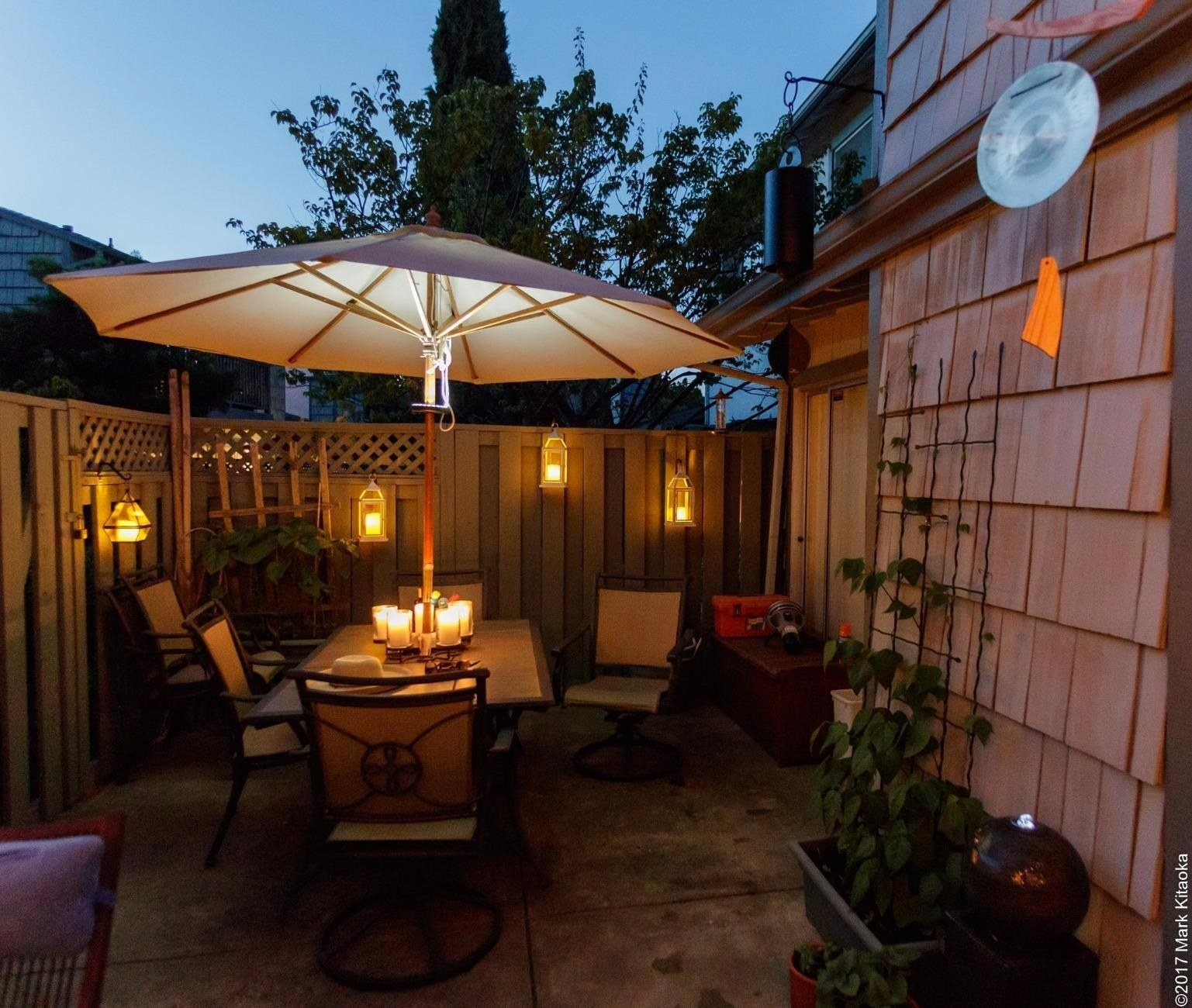 An outdoor patio bright with light from the umbrella patio light.
