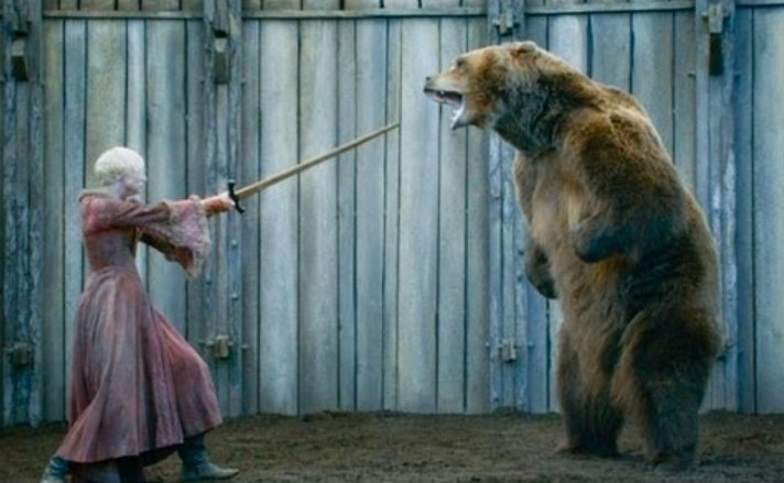 Still from Game of Thrones: Brienne fights a bear with a wooden sword