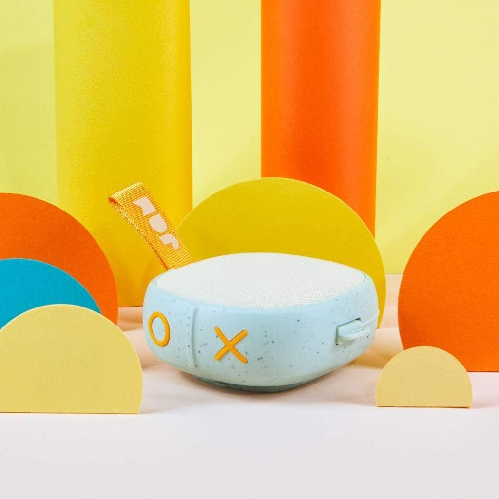Eggshell blue speckled hand-sized speaker with orange on and off buttons