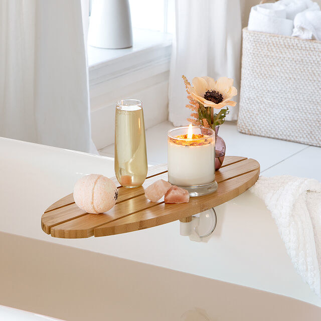 Oval tray made from multiple wooden slats connected to side of tub