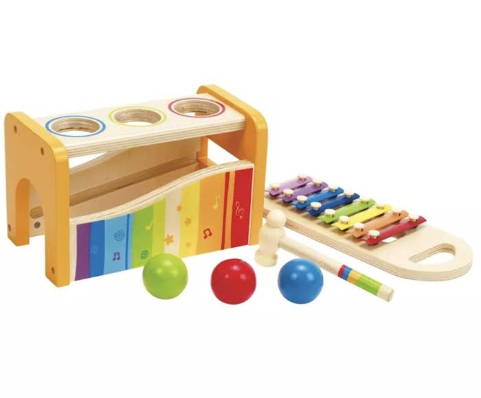A colorful tap and pound bench with three balls that can be hit with a hammer onto a xylophone