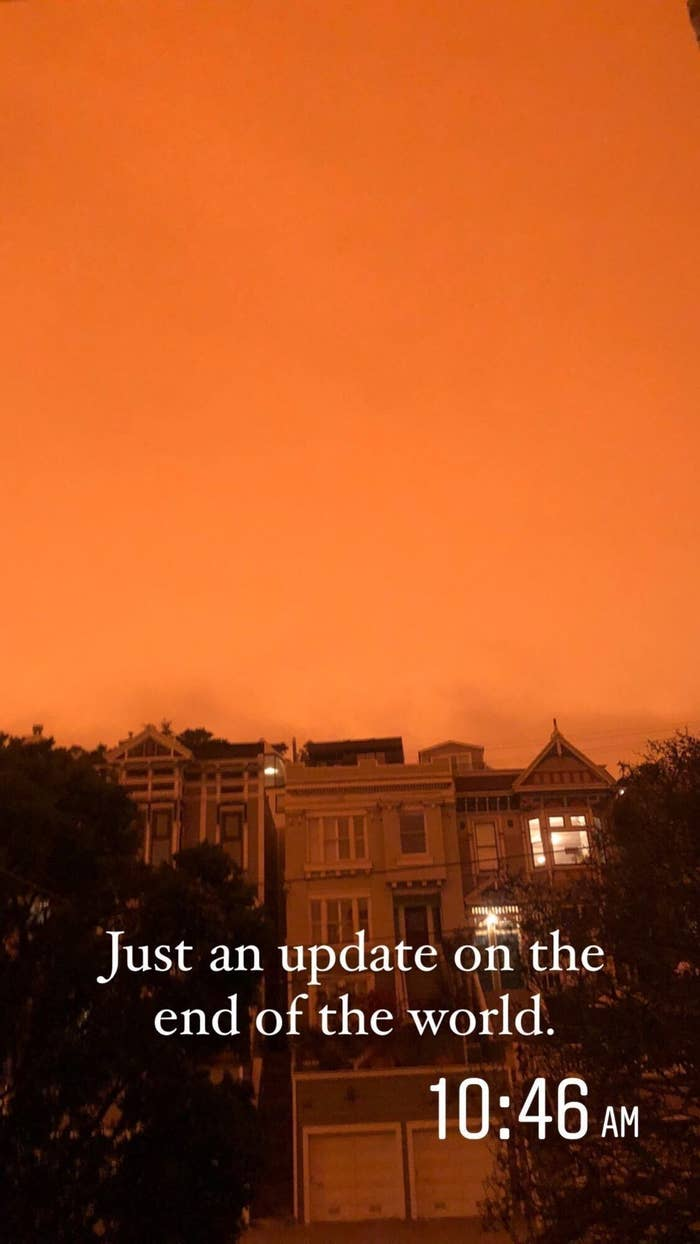 """The authors photo of dark orange skies taken in San Francisco, California at 10:46 am with the caption, """"Just an update on the end of the world."""""""