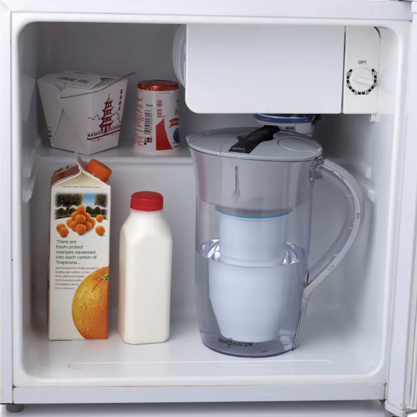 An 8-cup round water filtering pitches sits inside a mini-fridge with other food