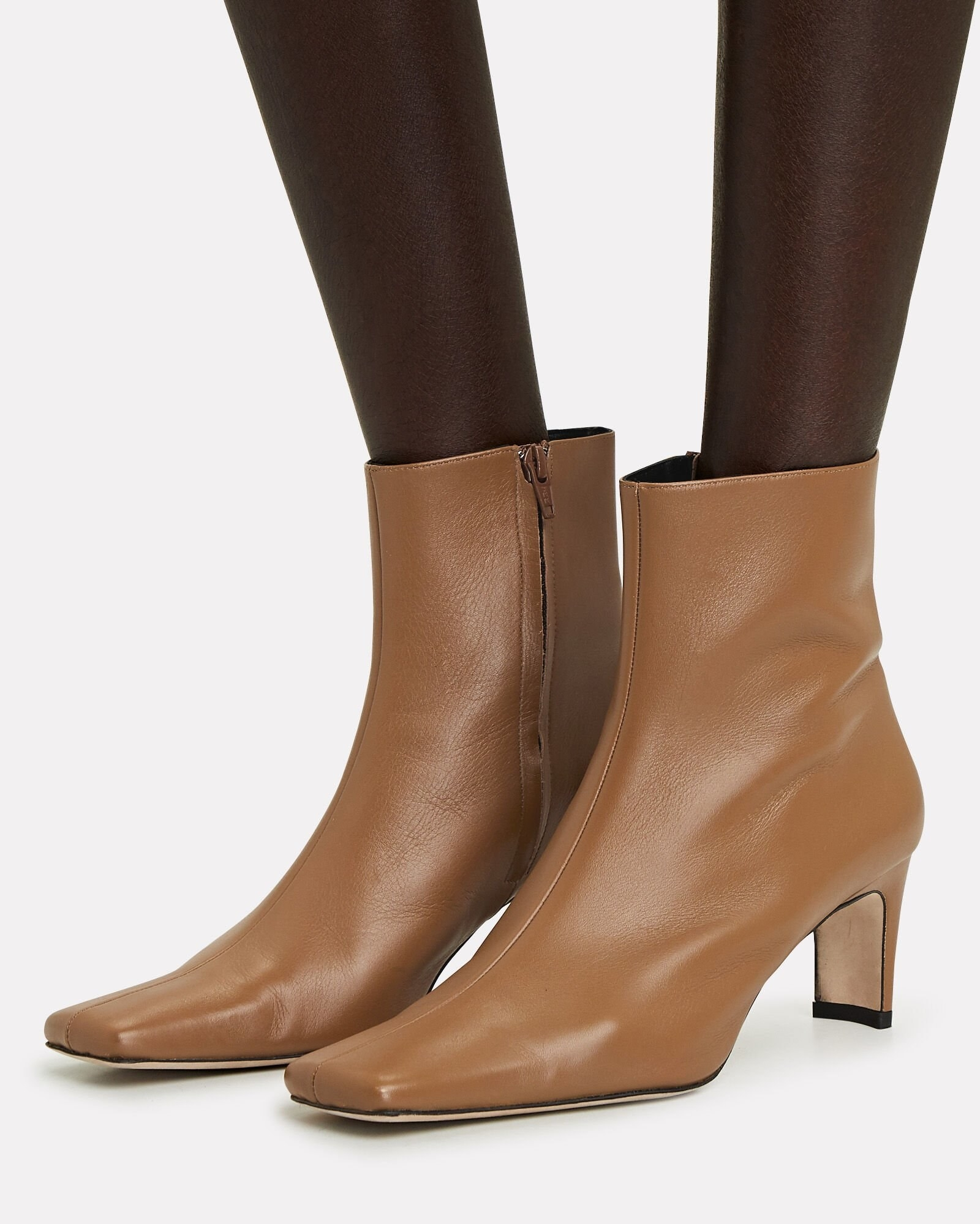 model wearing the brown pointed toe booties