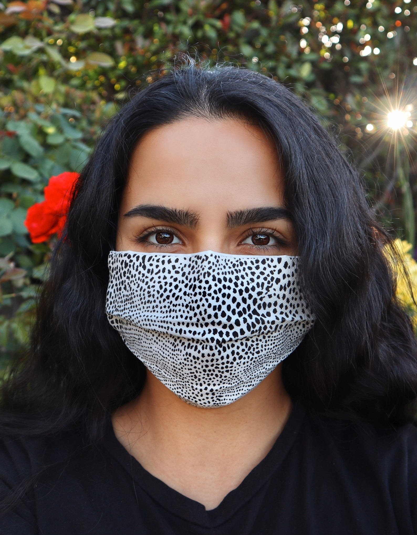 Model in white and black cheetah print face mask