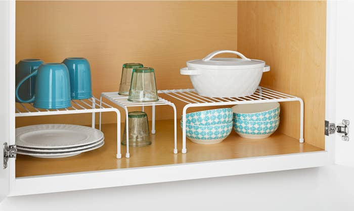 Set of three white shelves