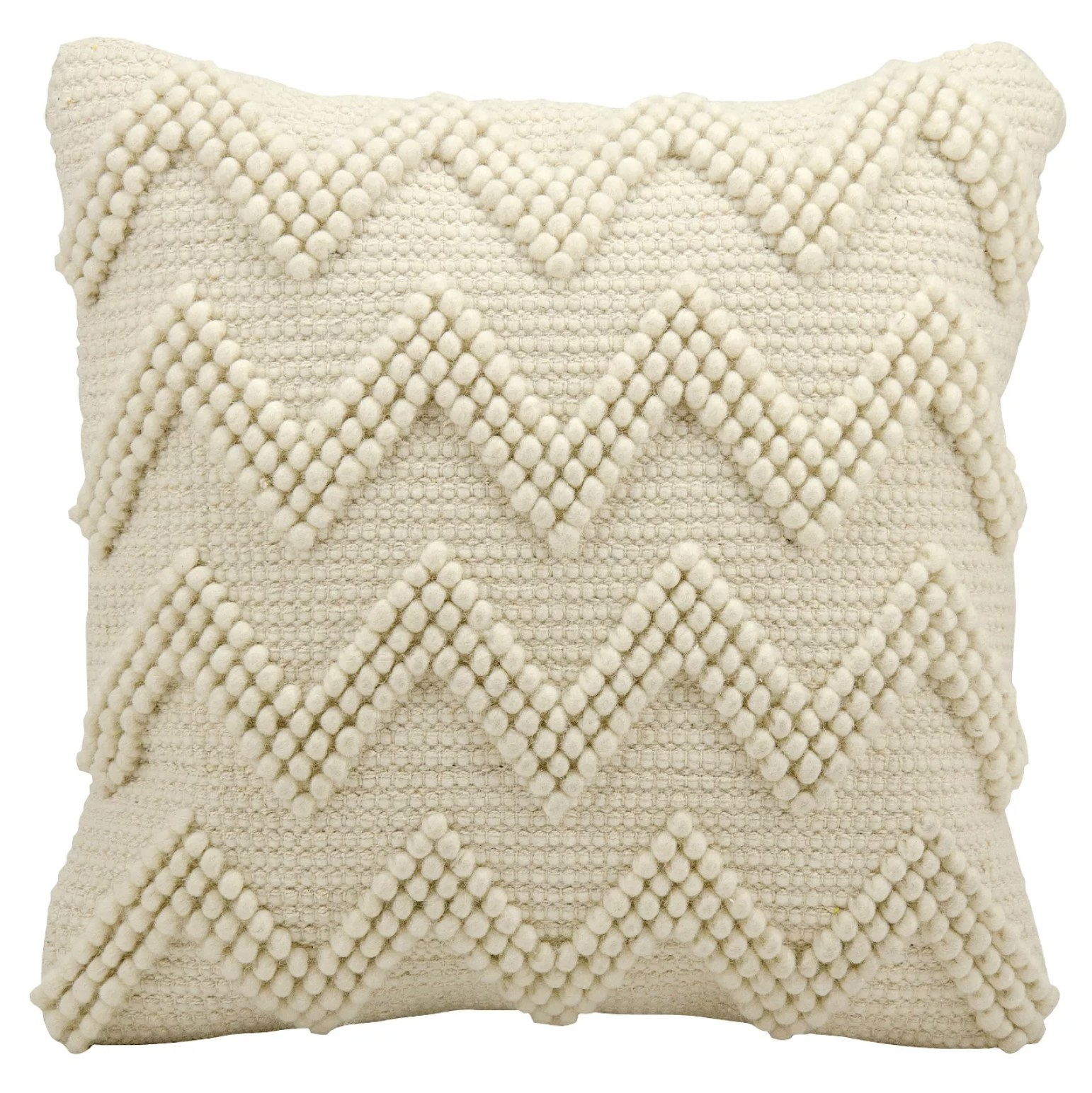 A cream throw pillow with a textured chevron design