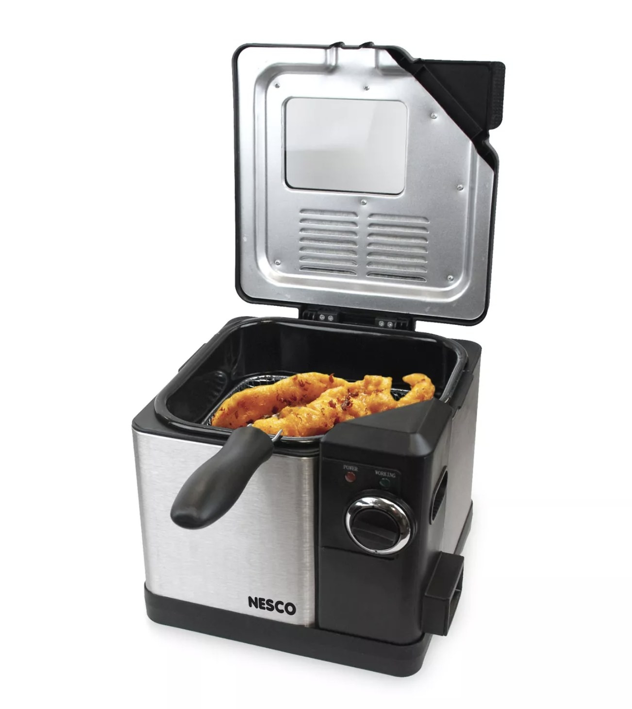 A stainless steel deep fryer open with fried fish filets inside