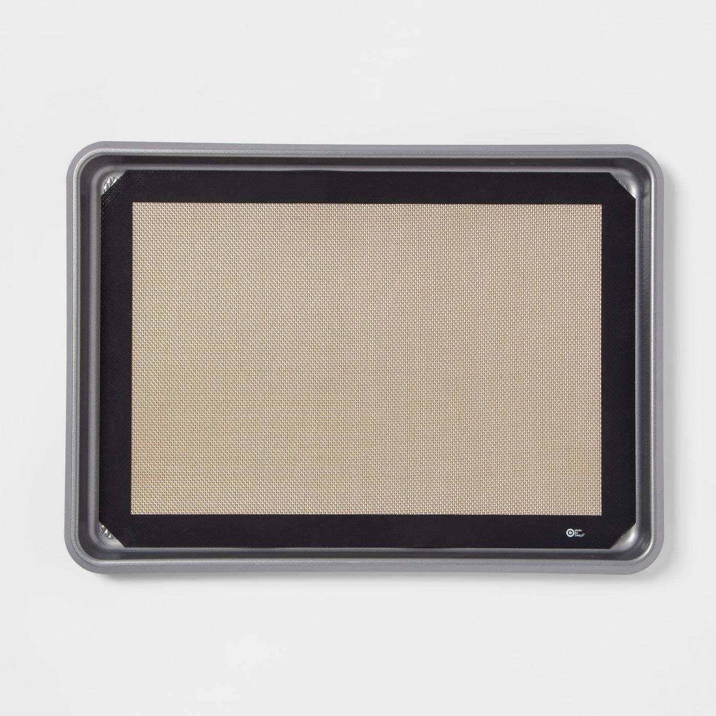 black framed silicone mat on top of a cookie sheet