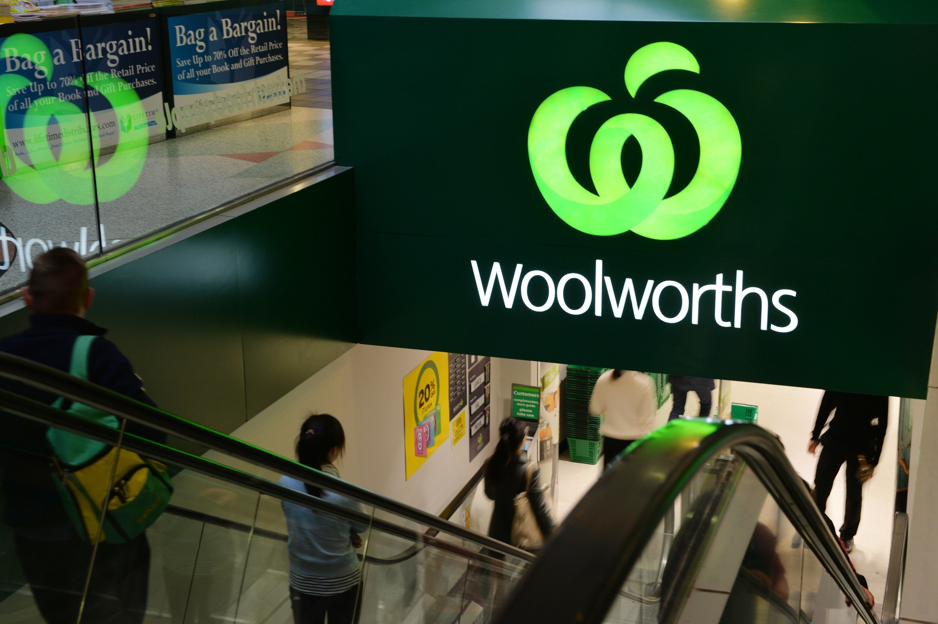 The escalator going down into an indoor Woolworths supermarket