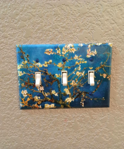 Reviewer uses three-toggle Vincent van Gogh-inspired art light switch cover on their off-white wall