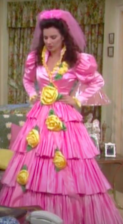 Fran Fine in a hot pink, multi layered, ruffled bridesmaid dress.