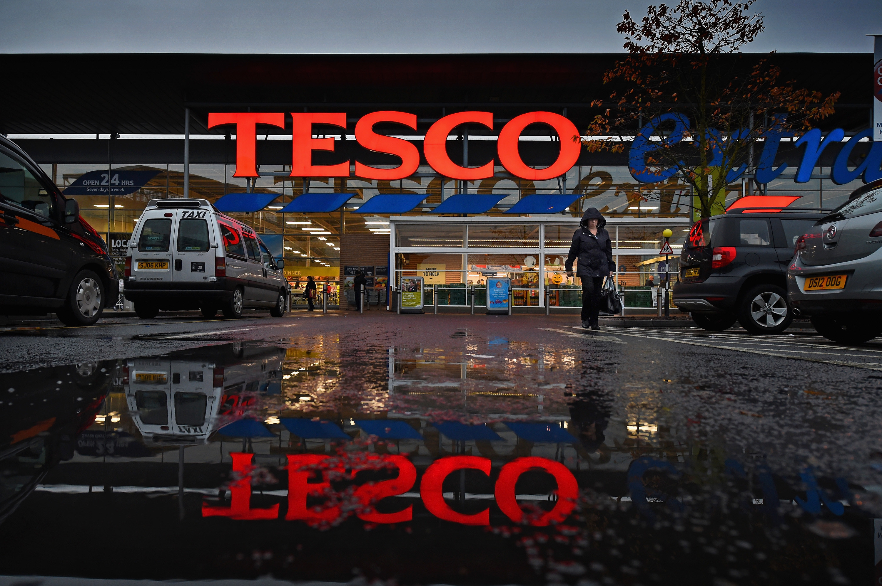 The exterior of a Tesco supermarket in the rain