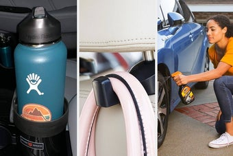 An oversized water bottle sitting in a large cup holder in a car, A bag hanging from a clip attached to the car headrest, A person spraying their car tire with cleaning solution