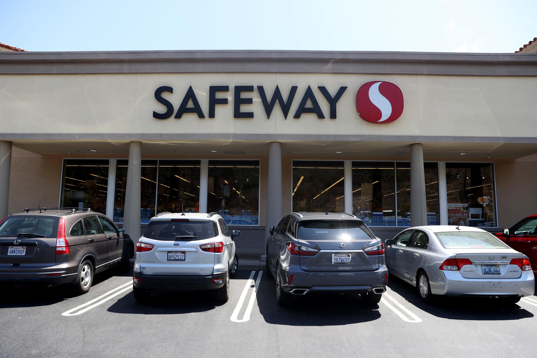 Cars parked outside a Safeway supermarket